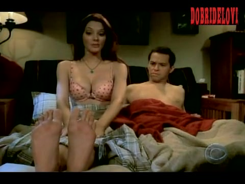 April Bowlby lays in bed with Jon Cryer scene from Two and a Half Man