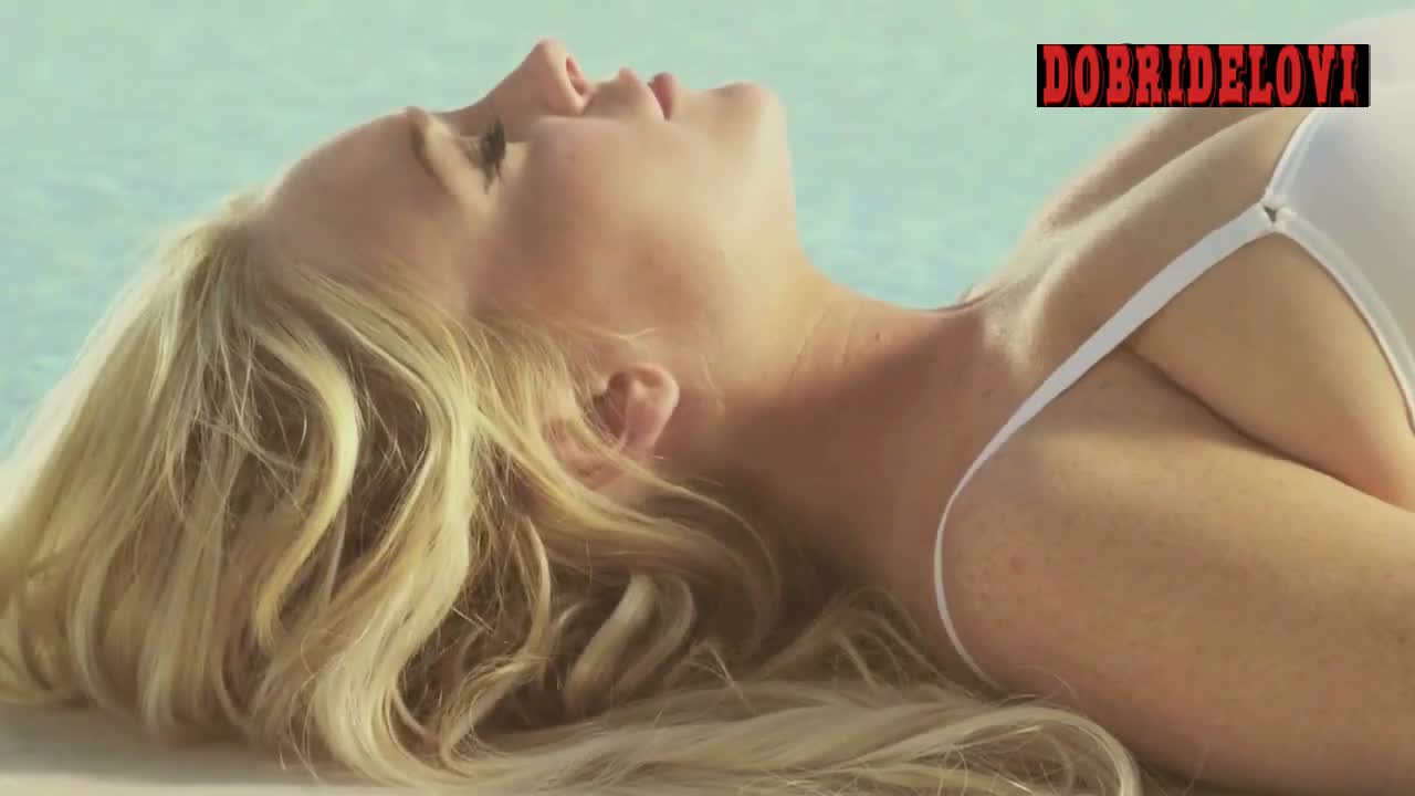 Lindsay Lohan lying poolside in sexy bikini scene from Lindsay Lohan