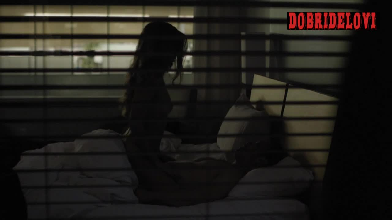 Riley Keough cowgirl scene through blinds from The Girlfriend Experience
