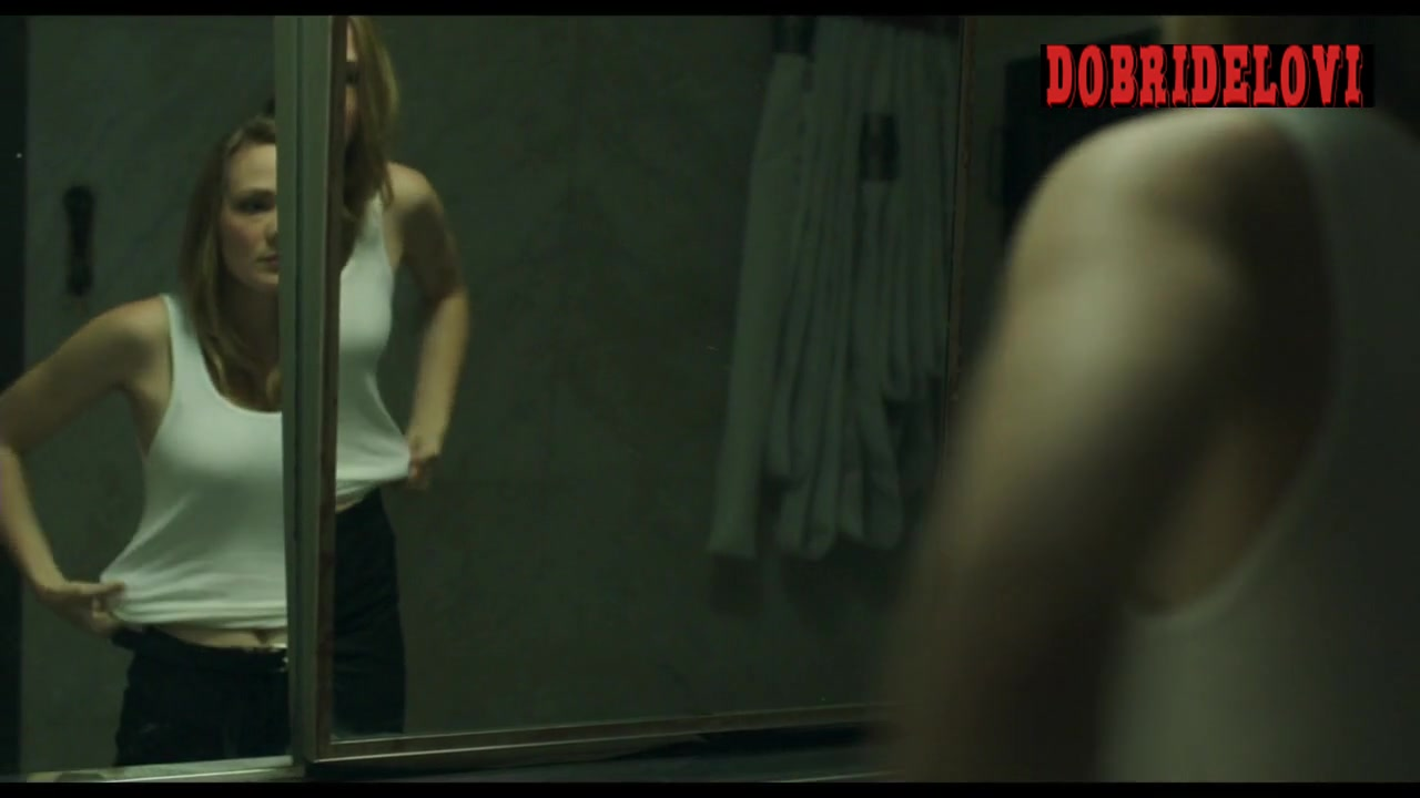 Louisa Krause putting on shirt scene from The Abandoned