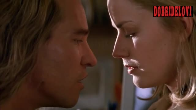 Elisabeth Shue rolls with Val Kilmer in The Saint