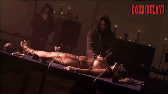 Sara Malakul Lane tied nude to an altar scene from 12/12/12