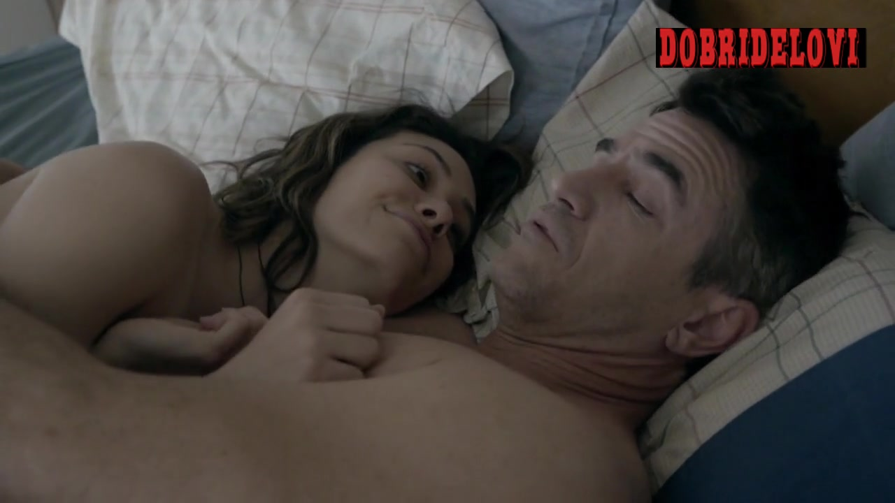 Emmy Rossum lays in bed with Dermot Mulroney scene from Shameless