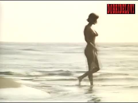 Ines Kotman distance view on beach scene from Lepota poroka