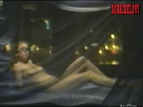 Diane Lane laying nude in bed scene from Lady Beware