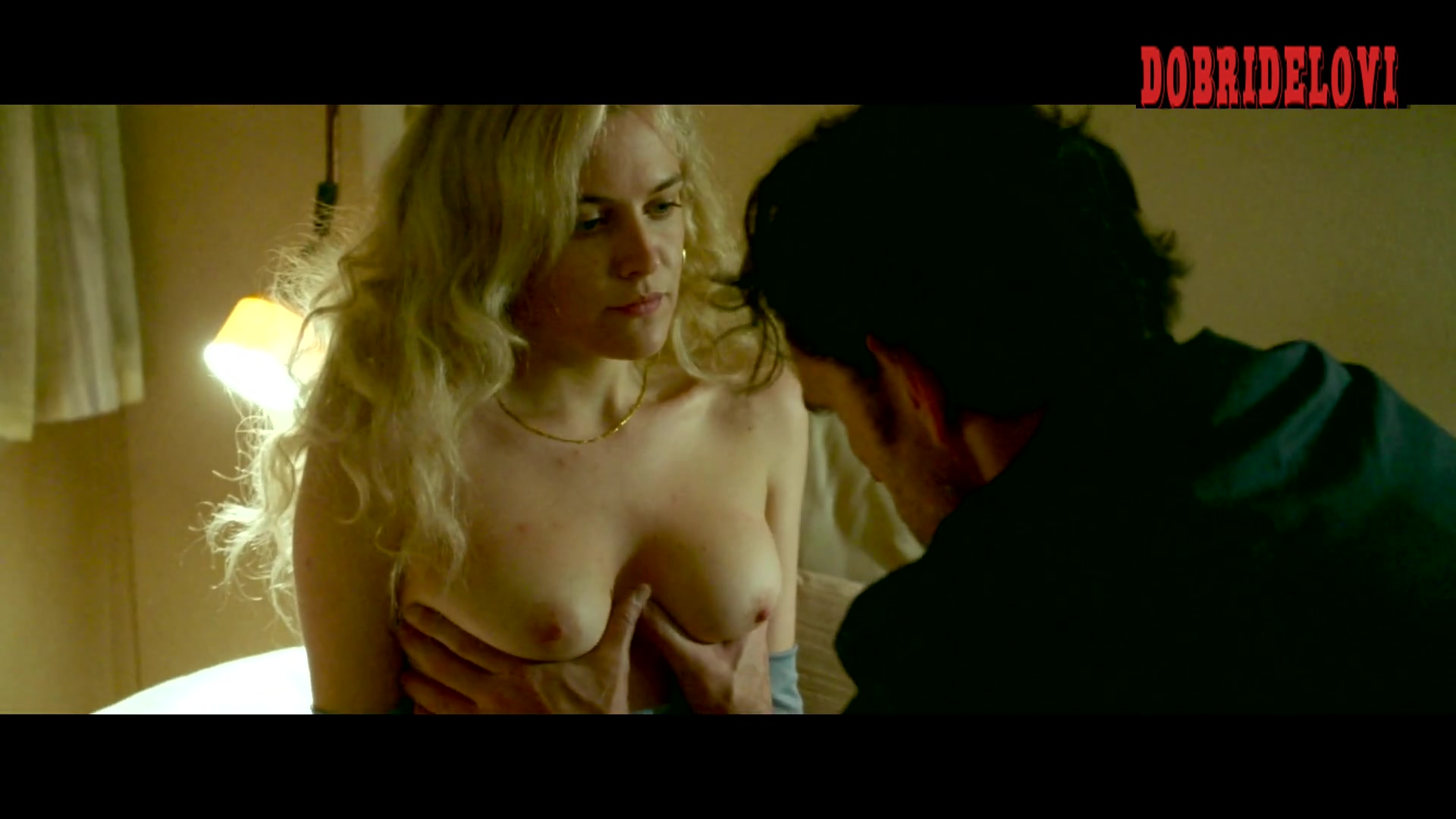 Riley Keough drawing on breasts scene from The House That Jack Built