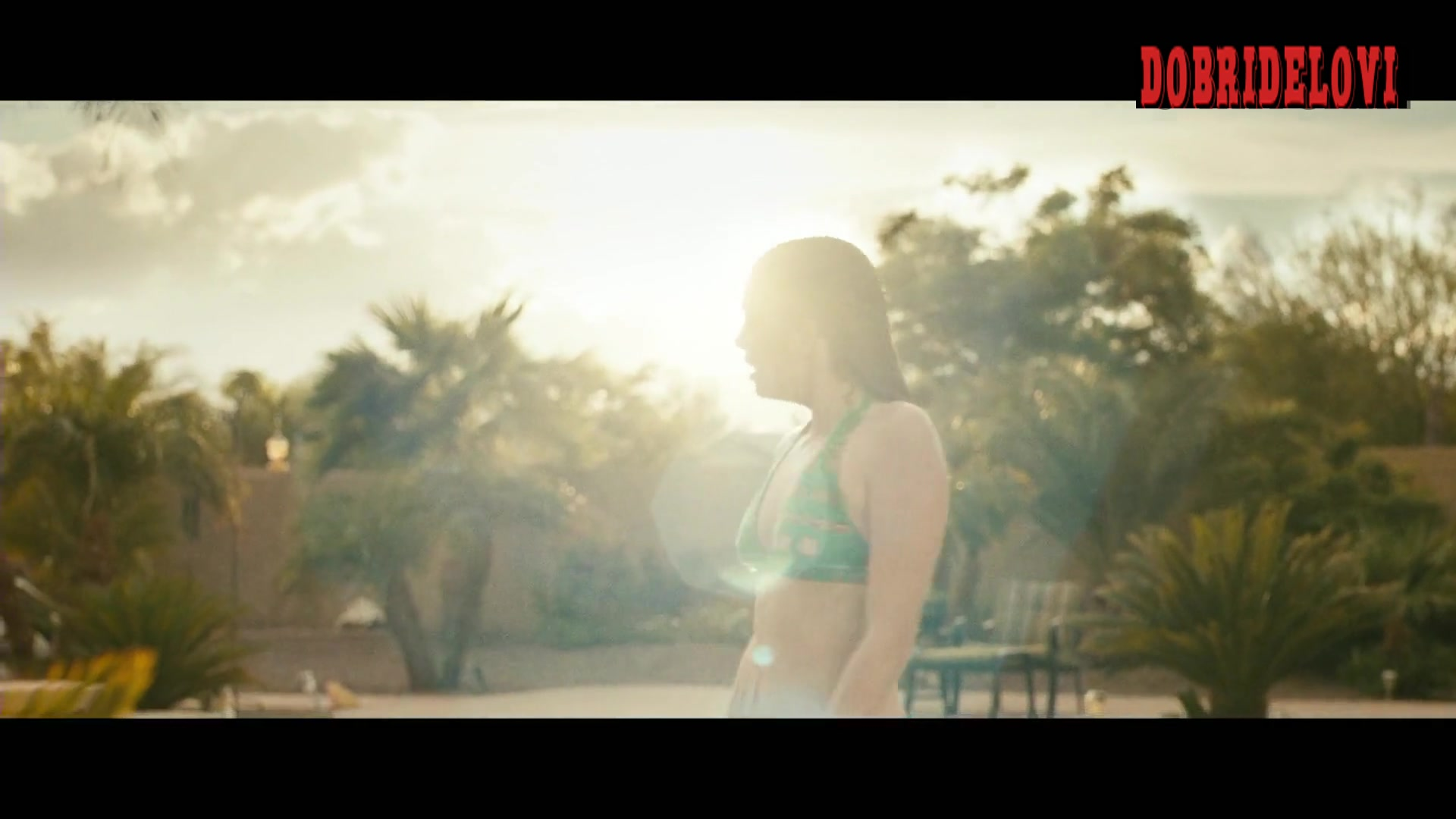 Watch Katherine Hughes green bikini scene from Monsoon video