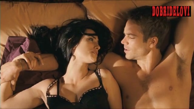 Penélope Cruz laying in bed with Paul Walker scene from Noel