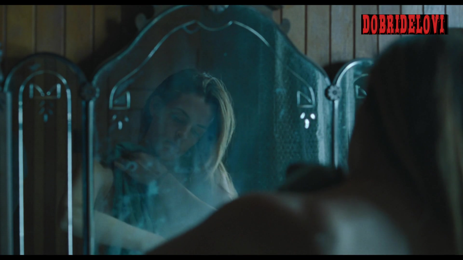Riley Keough in steamy bathroom scene from The Lodge