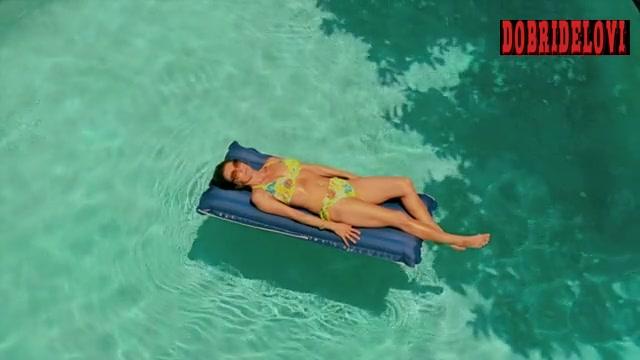 Diane Lane chilling in the swimming pool scene from Cinema Verite