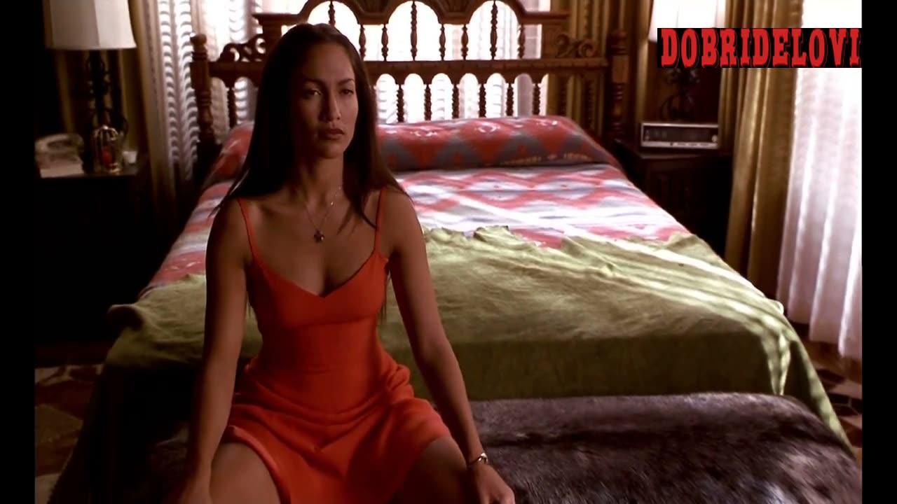 Jennifer Lopez sexy orange dress with legs spread for Sean Penn scene from U Turn