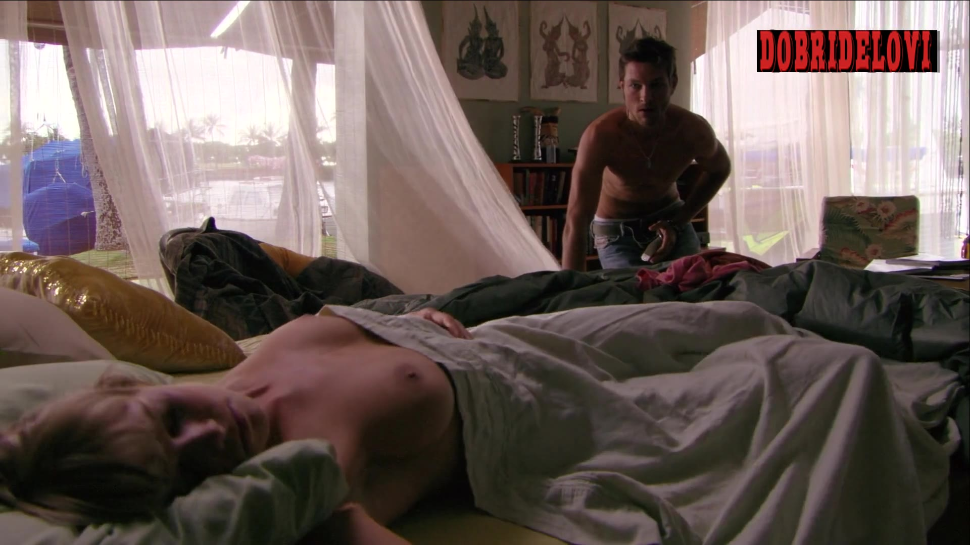 Mircea Monroe breast above sheet scene from Into the Blue 2: The Reef