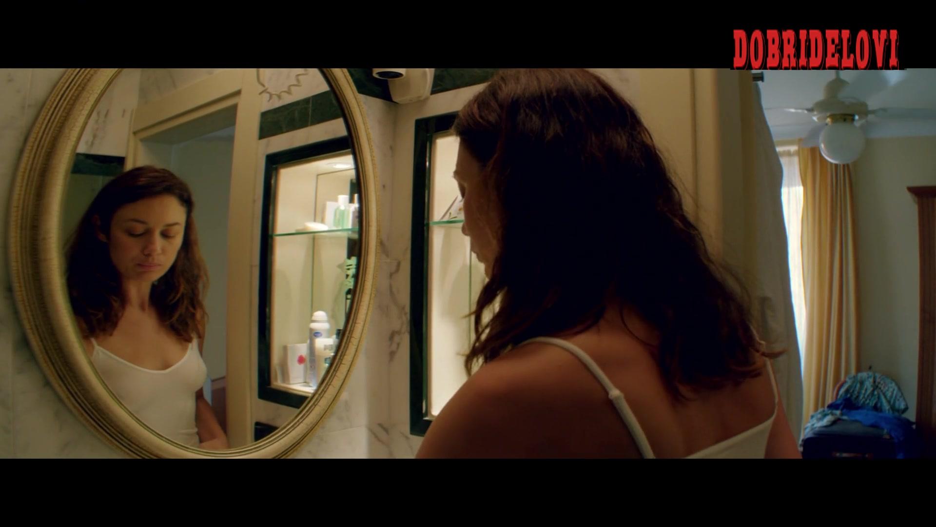 Olga Kurylenko see through mirror scene from The Bay of Silence