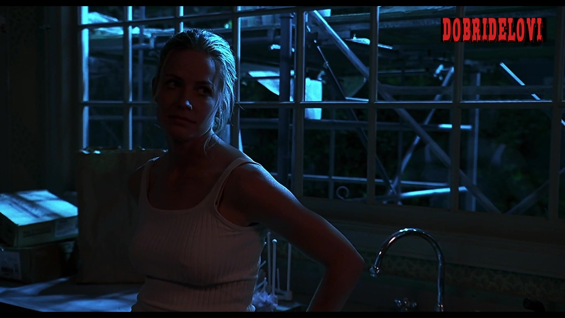 Elisabeth Shue pokies with white tank top scene from The Trigger Effect