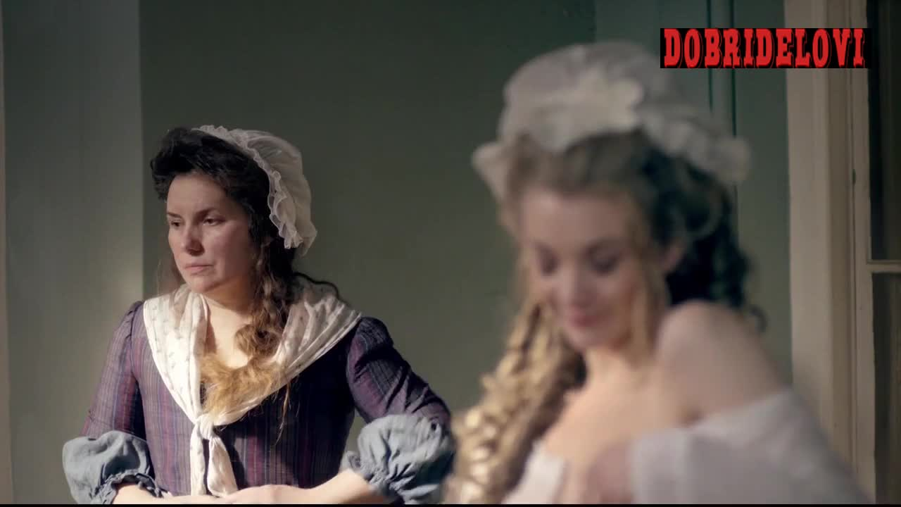 Natalie Dormer undressing with man peeping in window scene from The Scandalous Lady W