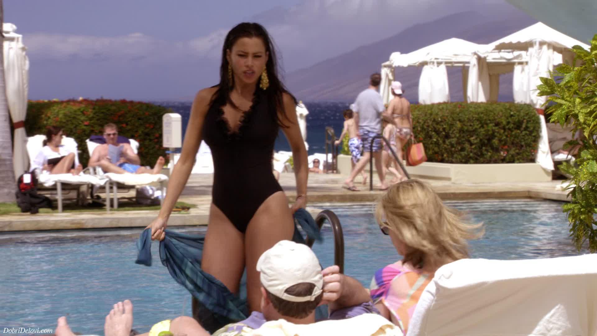 Sofia Vergara pool side in black bikini scene from Modern Family